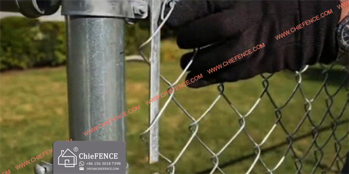 Chain link mesh must be pulled taut or it will sag. Stretching is done with a tool called a fence puller (A). Note location of the tension bar (B). Insert a pull bar through the unattached mesh a few feet from the final post (C). Attach the yoke to the pull bar.